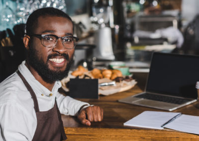 Business Owner setting at table
